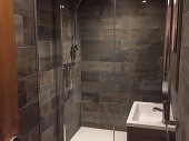 Basement Conversion Added Living Space and Luxury Shower Completed