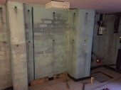 Installing the cavity drainage membrane to the walls