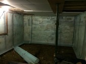 Fitting the cavity drainage membrane to the wall