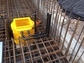 Sump pump chamber in situ within the reinforcement bars prior to laying the foundations